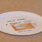 We placed paper plates in every seat of the cafeteria with messages asking for help and the address to vote
